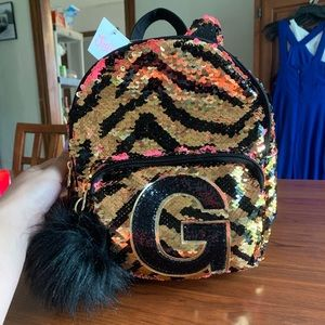"Justice ""G"" mini backpack"